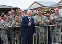 U.S. Vice President Michael R. Pence poses with service members for a photo at Joint Base Langley-Eustis, Va., April 29, 2017. Pence visited with the JBLE community before traveling to the  Newport News Shipyard  for the Christening Ceremony of the U.S. Navy's newest attack submarine. (U.S. Air Fore photo/Senior Airman Derek Seifert)