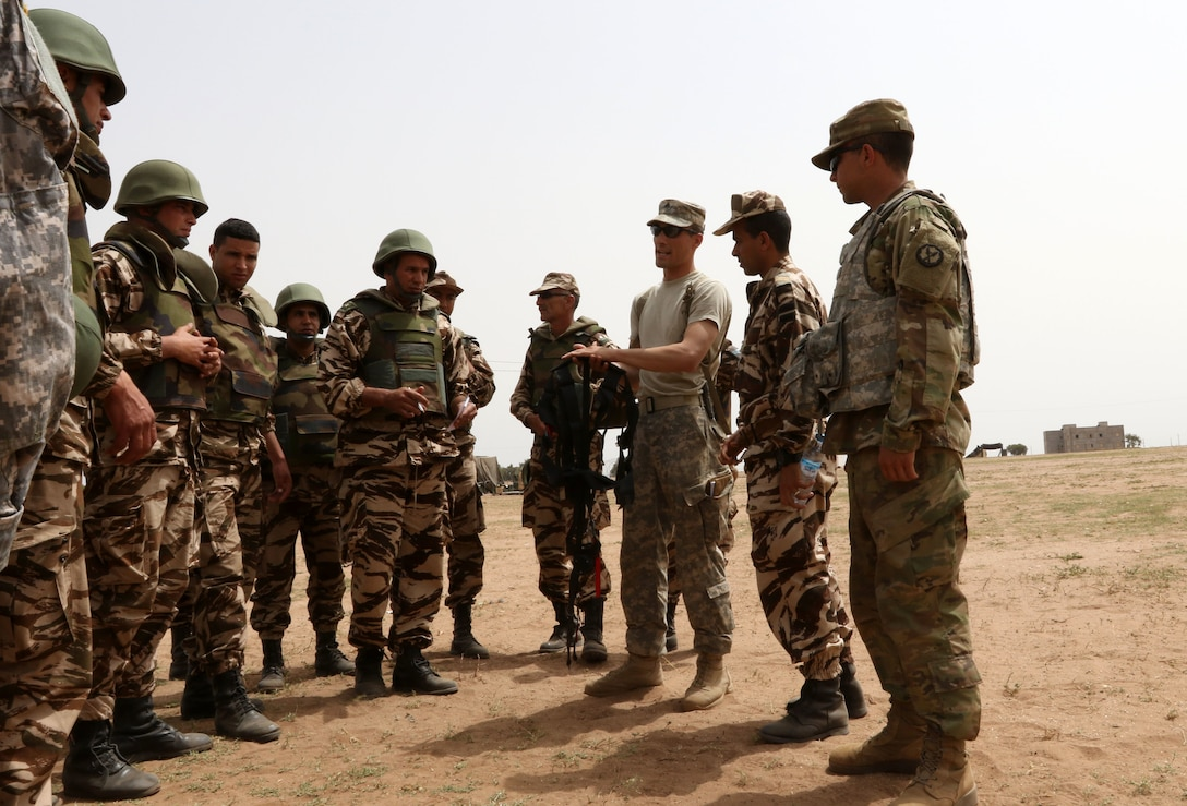 Army Sgt. Vincent Nutter, a military policeman with the 805th Military Police Company in Cary, North Carolina, explains the importance of a gunner's harness to Royal Moroccan Armed Forces at Tifnit, Morocco, on April 22, 2017, during Exercise African Lion. Exercise African Lion is an annually scheduled, combined multilateral exercise designed to improve interoperability and mutual understanding of each nation's tactics, techniques and procedures.