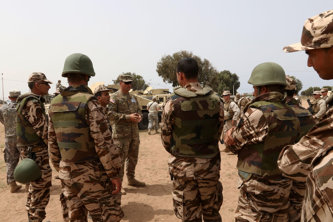 Army Sgt. Bradley Byrd, a military policeman with the 805th Military Police Company in Cary, North Carolina, explains convoy tactics to the Royal Moroccan Armed Forces in TIfnit, Morocco, on April 22, 2017, during Exercise African Lion. Exercise African Lion is an annually scheduled, combined multilateral exercise designed to improve interoperability and mutual understanding of each nation's tactics, techniques and procedures.