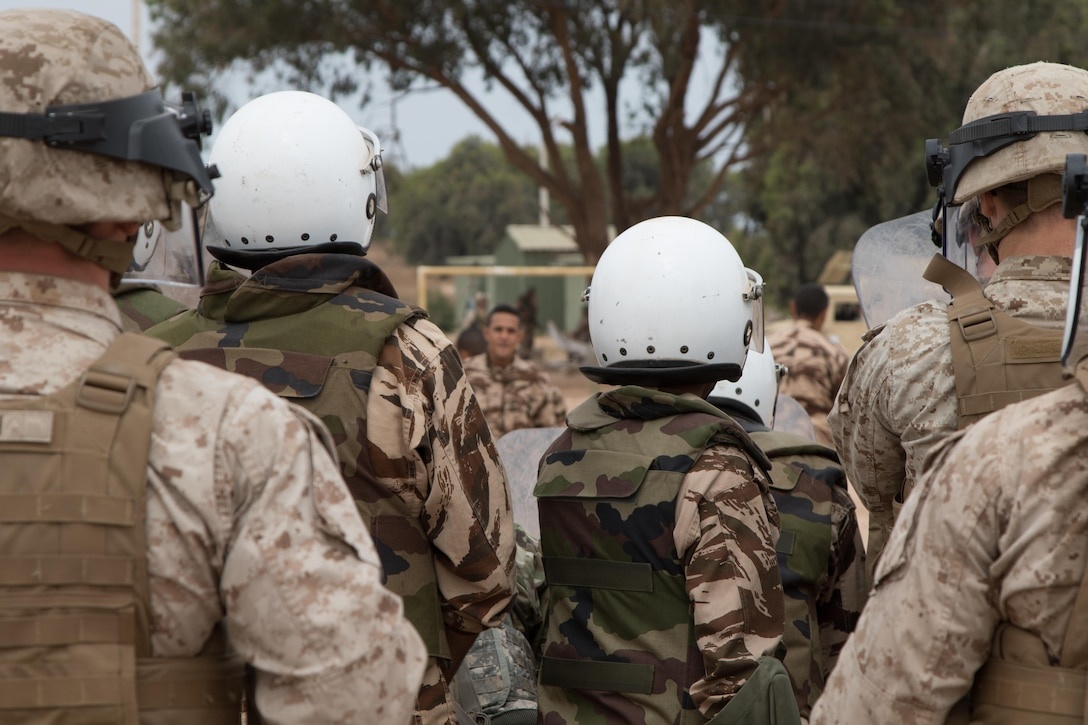 Marine Company B, 4th Law Enforcement Battalion from Pittsburg, Pennsylvania, and Royal Moroccan Armed Forces defend against rioters during crowd control training in Tifnit, Morocco, on April 24, 2017, during Exercise African Lion. Exercise African Lion is an annually scheduled, combined multilateral exercise designed to improve interoperability and mutual understanding of each nation's tactics, techniques and procedures.