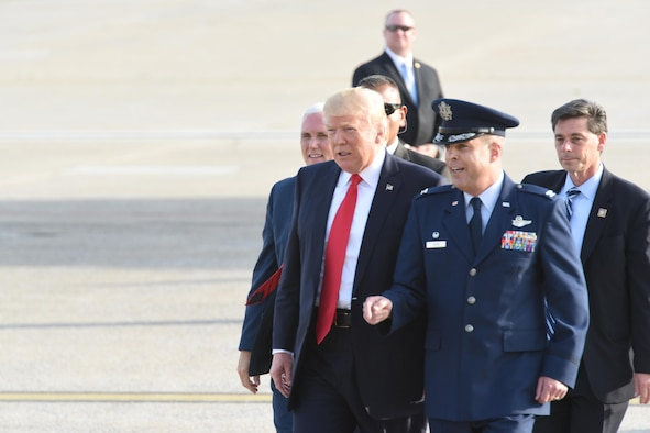 """President Donald J. Trump and Vice President Mike Pence walk with 193rd Special Operation Wing Commander Benjamin """"Mike"""" Cason over to 193rd SOW Airmen, and Airmen's family and friends, to shake their hands, Middletown, Pennsylvania, April 29, 2017. The President and Vice President landed at the 193rd SOW and were on their way the Harrisburg Farm Show Complex for President Trump's 100th day rally when they made time to greet those that awaited their arrival. (U.S. Air National Guard Photo by Master Sgt. Culeen Shaffer/Released)"""