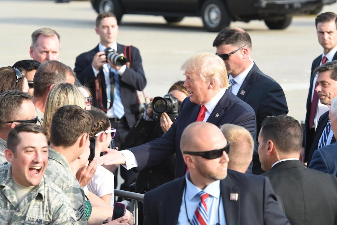 President Donald J. Trump and Vice President Mike Pence shake the hands of 193rd Special Operations Wing Airmen, and Airmen's family and friends, Middletown, Pennsylvania, April 29, 2017. The President and Vice President landed at the 193rd SOW and were on their way the Harrisburg Farm Show Complex for President Trump's 100th day rally when they made time to greet those that awaited their arrival. (U.S. Air National Guard Photo by Master Sgt. Culeen Shaffer/Released)