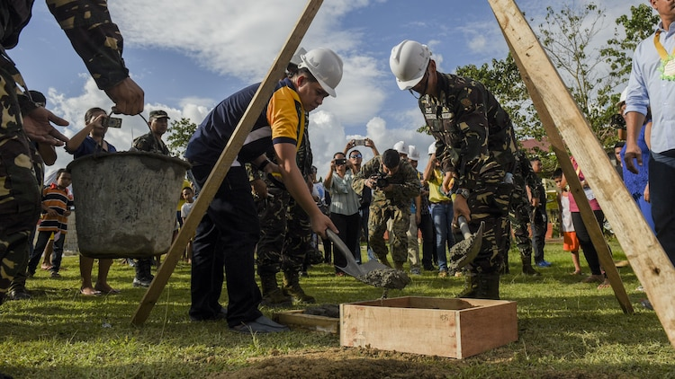 Leaders from the Armed Forces of the Philippines and city officials bury a time capsule during a groundbreaking ceremony for Balikatan 2017 in Ormoc City, Leyte, April 25, 2017. Leaders from the Armed Forces of the Philippines, U.S. military, and Ormoc City gathered to commemorate the beginning of engineering projects for new classrooms at Margen Elementary School in Ormoc City. Balikatan is an annual U.S.-Philippine military bilateral exercise focused on a variety of missions, including humanitarian assistance and disaster relief and counterterrorism.