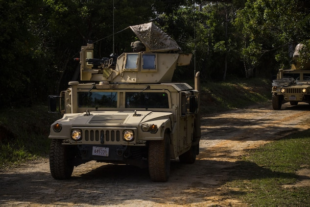 Marines conduct a mounted patrol at Central Training Area, Camp Hansen, Okinawa, Japan, April 18, 2017. 3d Law Enforcement Battalion conducted a Marine Corps Combat Readiness Evaluation to test each company's ability to execute tasks ranging from policing operations to police patrolling, route regulations, key leader engagements in towns and local population centers, security of key infrastructure, identity operations and law enforcement operations in an expeditionary environment to ensure they are prepared to support the operational requirements of III Marine Expeditionary Force. The Marines are with Charlie Company, 3d LE Bn, III MEF Force Headquarters Group. (U.S. Marine Corps photo by Lance Cpl. Joshua Pinkney)