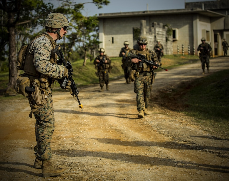 Marines conduct a dismounted patrol at Central Training Area, Camp Hansen, Okinawa, Japan, April 19, 2017. 3d Law Enforcement battalion conducted a Marine Corps Combat Readiness Evaluation to test each company's ability to execute tasks ranging from policing operations to police patrolling, route regulations, key leader engagements in towns and local population centers, security of key infrastructure, identity operations and law enforcement operations in an expeditionary environment to ensure they are prepared to support the operational requirements of III Marine Expeditionary Force. The Marines are with Charlie Company, 3d LE Bn, III MEF Headquarters Group. (U.S. Marine Corps photo by Lance Cpl. Joshua Pinkney)