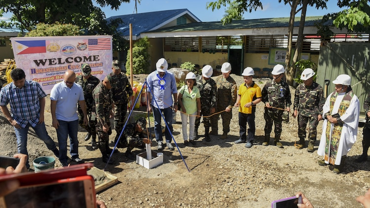 Leaders from the Armed Forces of the Philippines, U.S. military, and Ormoc City bury a time capsule to commemorate the beginning of engineering projects for new classrooms during Balikatan 2017 at Don Carlos Elementary School in Ormoc City, Leyte, April 25, 2017. Balikatan is an annual U.S.-Philippine military bilateral exercise focused on a variety of missions, including humanitarian assistance and disaster relief and counterterrorism.