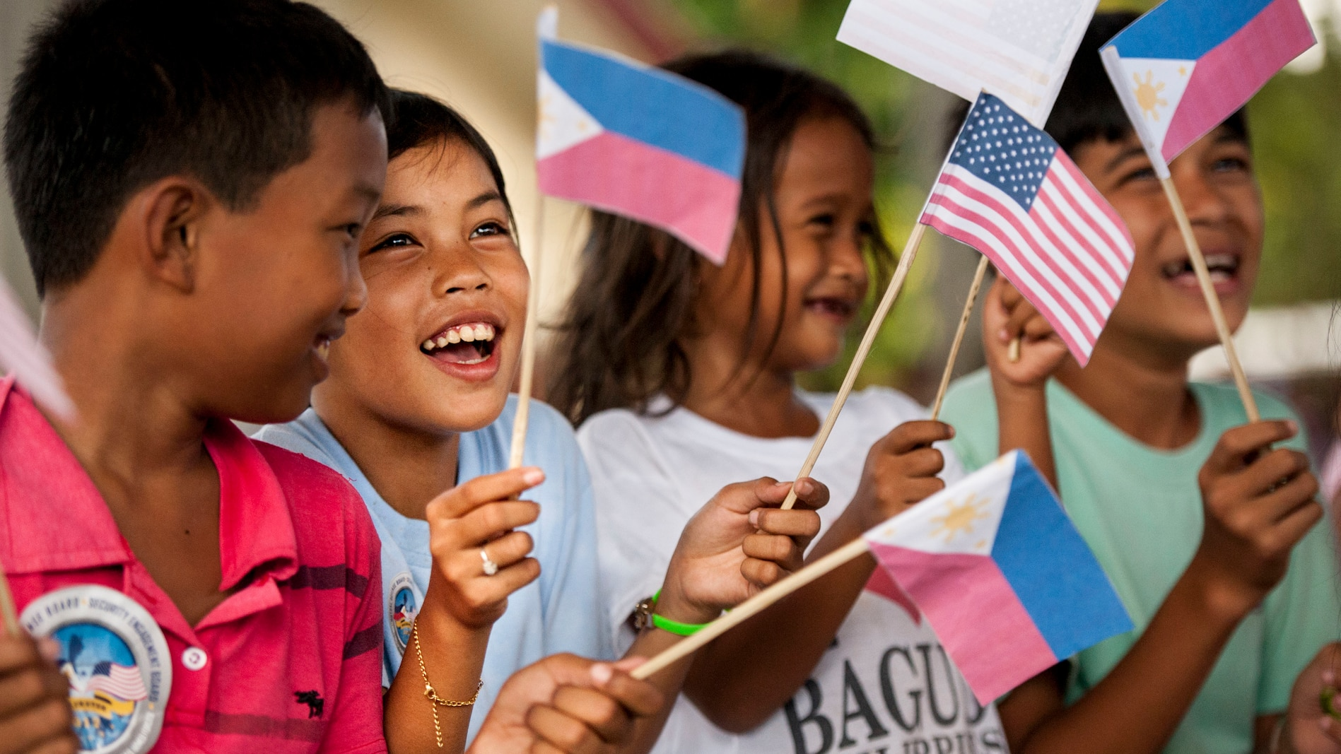 Filipino children wave U.S. and Philippine flags during a groundbreaking ceremony for Balikatan 2017 in Ormoc City, Leyte, April 25, 2017.