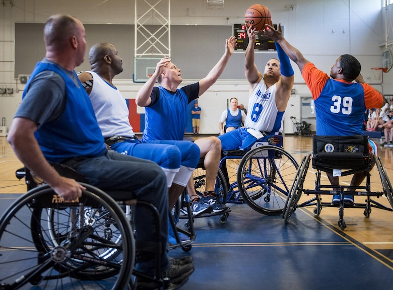 Brian Williams, an Air Force Warrior Games wheelchair basketball player, tries to hold onto the ball during a scrimmage game against base leadership on the final day of a training camp held at Eglin Air Force Base, Fla., April 28. The base-hosted, week-long Warrior Games training camp is the last team practice session before the yearly competition in June. (U.S. Air Force photo/Samuel King Jr.)