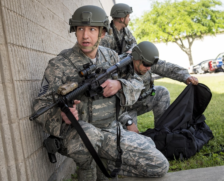 Master Sgt. Shane Zugai, 96th Security Forces Squadron, watches the building's entrance during an active shooter exercise at Eglin Air Force Base, Fla., April 11.  The goal of the exercise was to evaluate people's knowledge and response at the active shooter location and select lockdown locations.  (U.S. Air Force photo/Samuel King Jr.)