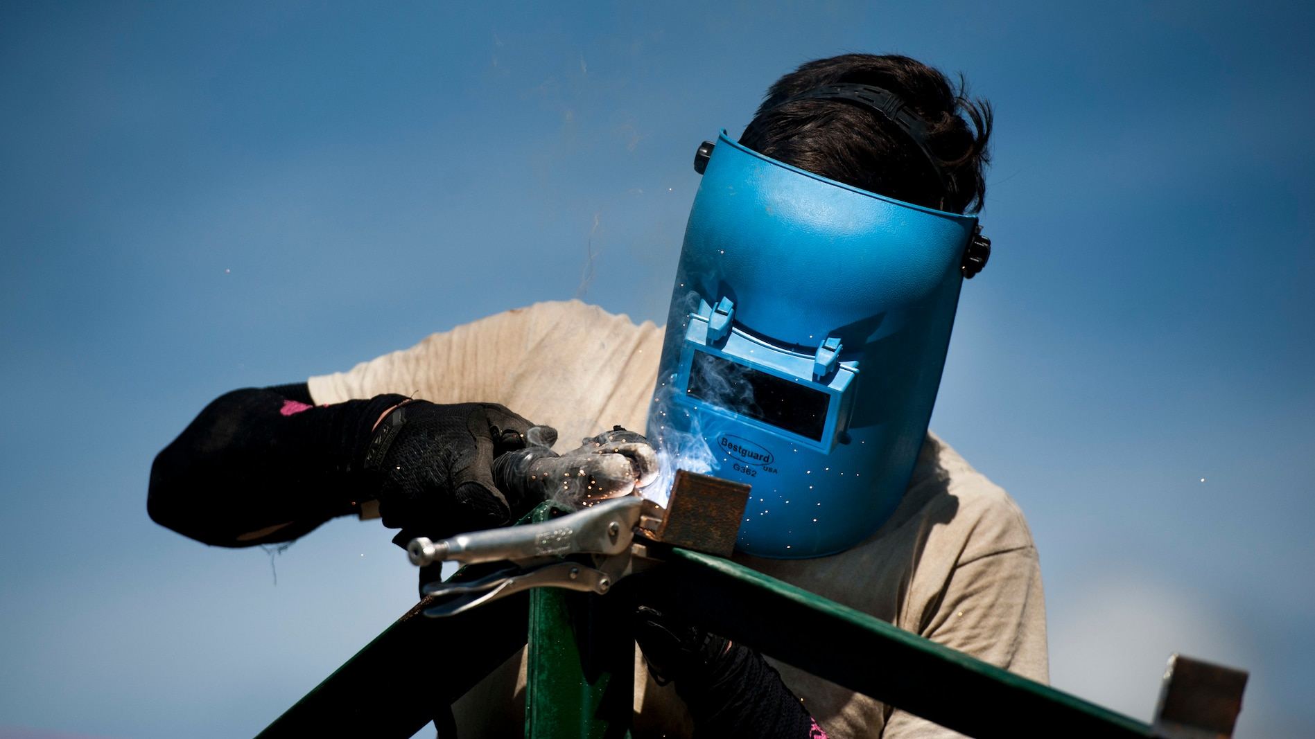 U.S. Air Force Airman 1st Class Adrian Wance welds brackets to roof-support beams during Balikatan 2017 in Ormoc City, Leyte, April 27, 2017.