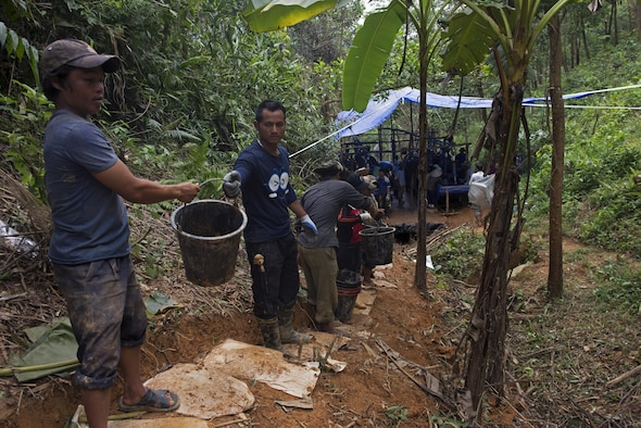 Vietnamese personnel transport soil during a recovery operation with members from the Defense POW/MIA Accountability Agency in Phuoc Son providence, Vietnam, May 27, 2017. DPAA team members deployed to the area in hopes of recovering the remains of a service member unaccounted for from the Vietnam conflict. (U.S. Air Force photo by Staff Sgt. David Owsianka)