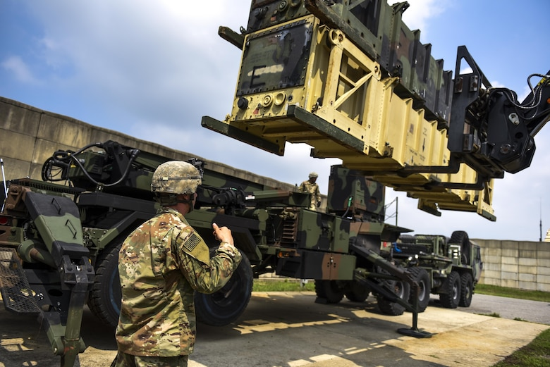 U.S. Army Spc. Justin Maurer, Alpha Battery, 2nd Battalion, 1st Air Defense Artillery Regiment patriot missile operator and maintainer, guides a fork lift while maneuvering dummy munitions on a patriot missile system at Kunsan Air Base, Republic of Korea, July 27, 2017. A/2-1 members participated in training that included proper 24-hour manning and changeover for crew operations, Patriot Launcher reloads, and Operational Readiness Evaluations. (U.S. Air Force photo by Senior Airman Michael Hunsaker/Released).