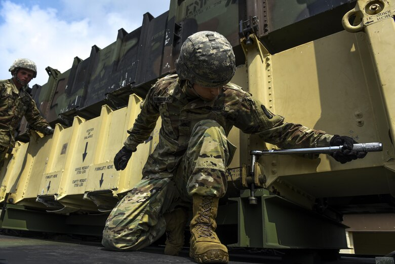 U.S. Army Pfc. Brandon Rodriguez, Alpha Battery, 2nd Battalion, 1st Air Defense Artillery Regiment patriot missile operator and maintainer, tightens a bolt during patriot missile system reload training at Kunsan Kunsan Air Base, Republic of Korea, July 27, 2017. Members of A/2-1 conducted training on operation, manning, sustainment, and employment of the Patriot Weapons system. (U.S. Air Force photo by Senior Airman Michael Hunsaker/Released).