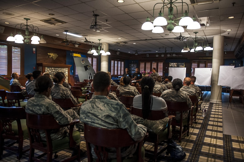 U.S. Air Force members attend a Leanin Together luncheon on Aug. 26, 2017 at Kunsan Air Base, Republic of Korea. The Leanin Together luncheon allows women and men to recognize and work through internal and external barriers with guidance from female leaders and the support of men. (U.S. Air Force photo by Senior Airman Colville McFee/Released)