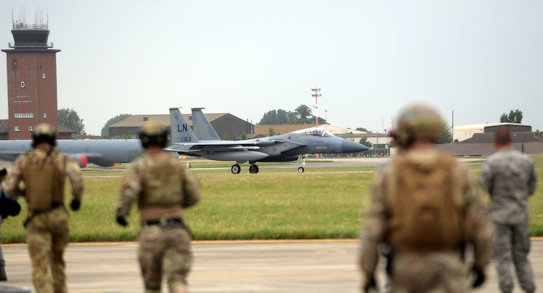 A U.S. Air Force F-15C Eagle lands on RAF Mildenhall, England, before being refueled by an MC-130J Commando II July 26, 2017. Exercise Rapid Eagle is the first time a Forward Arming and Refueling Point exercise was conducted with an MC-130 and an F-15C. (U.S. Air Force photo by Airman 1st Class Luke Milano)