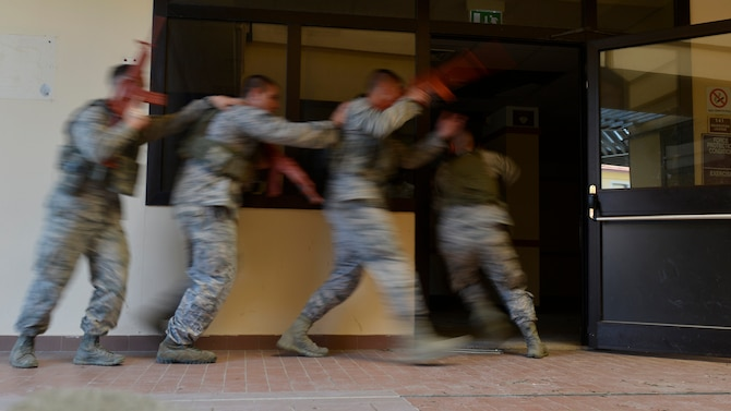 Airmen from the 31st Security Forces Squadron enter a room during close-quarters battle training, July 27, 2017, at Aviano Air Base, Italy. The defenders learned how to work together in small teams to secure an area from enemy threats. (U.S. Air Force photo by Senior Airman Cary Smith)