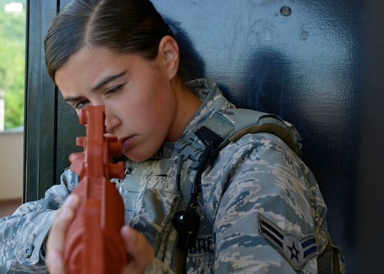 Airman 1st Class Elizabeth Barth, 31st Security Forces Squadron security response team member, guards a door during close-quarters battle training, July 27, 2017, at Aviano Air Base, Italy. During the training, defenders learned how to work together in small teams to secure areas from enemy threats. (U.S. Air Force photo by Senior Airman Cary Smith)