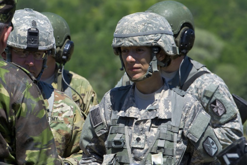 Army Spc. Gizela Lupescu translates for U.S. and Romanian soldiers during exercise Getica Saber 17 at the Joint National Training Center in Cincu, Romania, July 9, 2017. Lupescu immigrated from Romania in her twenties and joined the North Carolina Army National Guard as a combat medic specialist. Army photo by Sgt. Justin Geiger