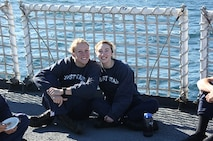 Cadets Susan West and Jennifer Haley soak up the sun on the flight deck.
