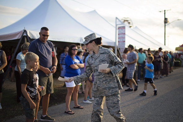 Senior Airman Karli Chaviano, 436th Aerospace Medicine Squadron, hands out Thunder Over Dover Open House flyers to parade spectators during the Delaware State Fair's Military Appreciation Day parade July 26, 2017, in Harrington, Del. The Thunder Over Dover Open House will take place Aug. 26 - 27, 2017, on Dover Air Force Base, Del. (U.S. Air Force photo by Capt. Bernie Kale)