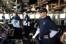 ENS Chris DiBari conns HEALY during an anchorage.