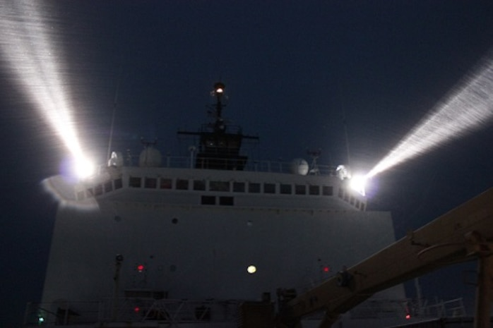 HEALY operating in the ice at night using searchlights.