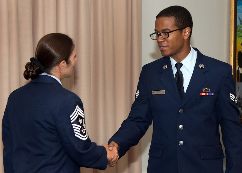 Senior Airman Quintin Rice, a member of the 66th Force Support Squadron, is congratulated by Command Chief Master Sgt. Patricia L. Hickey on his promotion to senior airman during the Monthly Enlisted Promotions Ceremony at the Minuteman Commons July 31. The ceremony, generally held the last duty day of the month, provides the Hanscom community an opportunity to recognize enlisted Airman selected for promotion. (U.S. Air Force photo by Mark Herlihy)