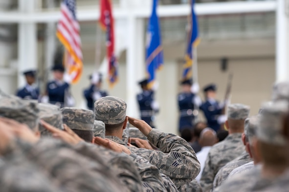 Members of the Tennessee Air National Guard hold a salute during the presentation of the colors by the 164AW Color Guard on Memphis Air National Guard Base. Memphis ANG Base is the first to partner with AFCEC on a UESC. (U.S. Air National Guard Photo by Staff Sgt. Allan Eason/Released)