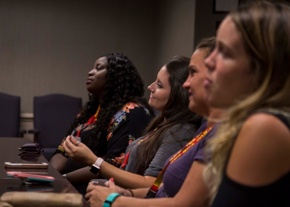 Spouses within 6th Marine Corps District (6MCD) listen to the welcoming brief for the District Spouse Orientation Course (DSOC) at Irby's Inn aboard Marine Corps Air Station Beaufort, South Carolina, July 25, 2017.  The DSOC provided Marines and their spouses a broad spectrum of tools to help them transition into the Marine Corps' recruiting field. The spouses came from across the District to build connections and network with fellow spouses. (U.S. Marine Corps photo by Lance Cpl. Jack A. E. Rigsby)