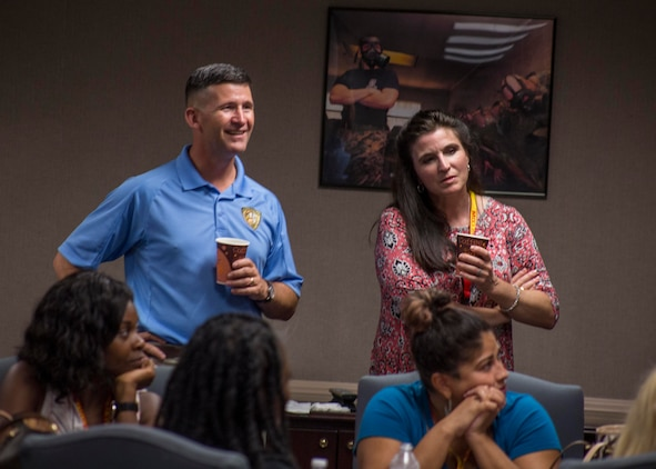 Colonel Jeffery C. Smitherman, Commanding Officer of 6th Marine Corps District (6MCD), left, and his wife, Nagelle Smitherman, right, listen to spouses introduce themselves during the welcoming portion of the District Spouse Orientation Course (DSOC) at Irby's Inn aboard Marine Corps Air Station Beaufort, South Carolina, July 25, 2017.  The DSOC provided Marines and their spouses a broad spectrum of tools to help them transition into the Marine Corps' recruiting field. The spouses came from across the District to build connections and network with fellow spouses. (U.S. Marine Corps photo by Lance Cpl. Jack A. E. Rigsby)