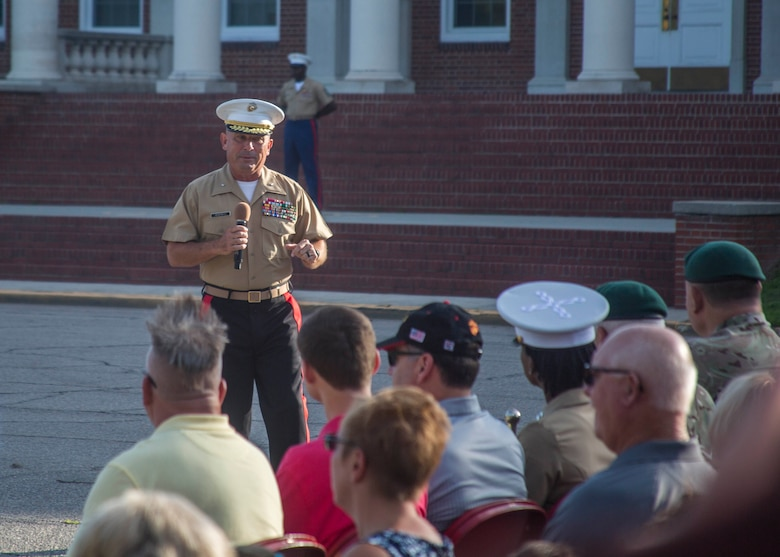 Brigadier General Austin E. Renforth, Commanding General of Eastern Recruiting Region and Marine Corps Recruit Depot (MCRD) Parris Island, South Carolina, speaks to spouses at the Morning Colors flag raising ceremony during the District Spouse Orientation Course (DSOC) aboard MCRD Parris Island, July 28, 2017.  The DSOC provided Marines and their spouses a broad spectrum of tools to help them transition into the Marine Corps' recruiting field. The spouses came from across the District to build connections and network with fellow spouses. (U.S. Marine Corps photo by Lance Cpl. Jack A. E. Rigsby)