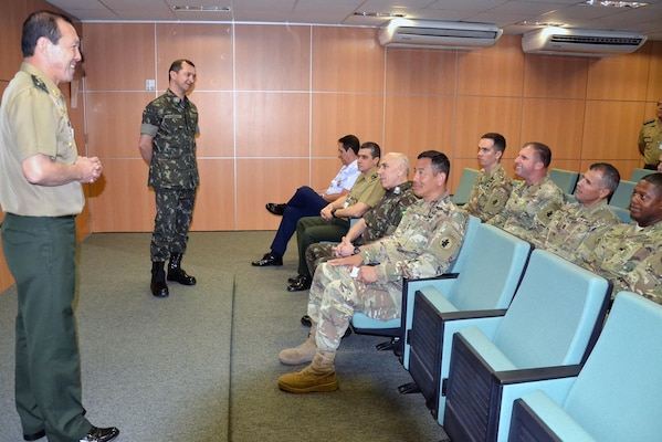 Lt. Gen Angelo Kawakami Okamura (left), commander of Brazil's Cyber Defense Command and Maj. Walbery Nogueira, cyber joint staff officer, brief delegates on the domain that overlaps every other domain of war during army-to-army staff talks in Brasilia, Brazil July 24.