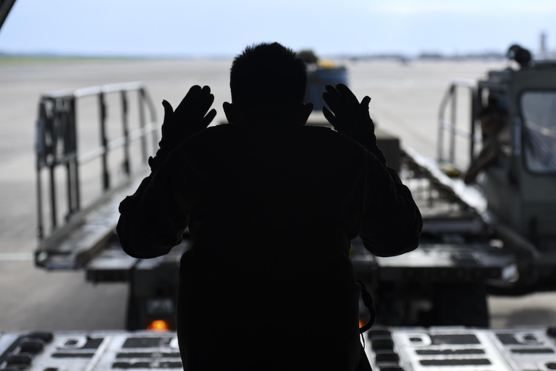 Senior Airman Jaypeter Tuazon, 61st Airlift Squadron loadmaster, loads training weights and a container delivery system onto a C-130J, Aug. 1, 2017, at Little Rock Air Force Base, Ark. Loadmasters manage the loading and offloading of cargo while keeping the aircraft's weight balanced and within flight limitations.