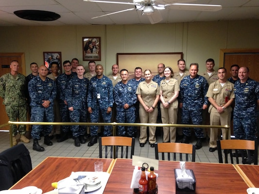 DLA Distribution Norfolk, Virginia, commander Navy Supply Corps Capt. Andrew Matthews and former DLA Distribution commander Navy Capt. Harry Thetford met with customers and several junior naval officers during a trip to Naval Submarine Base New London, Connecticut.