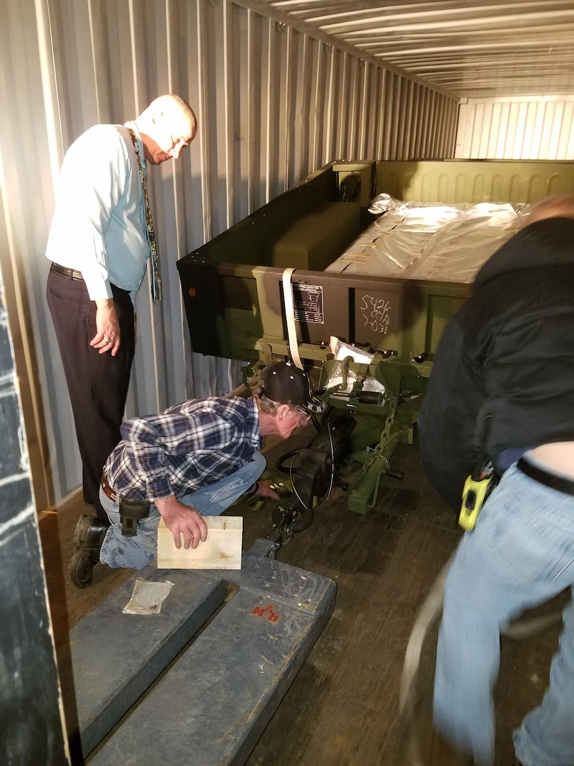 A DLA Distribution Tobyhanna Team work to find a safe manner to secure and ship four cargo trailers in the most effective, efficient and best value method possible.