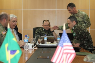 U.S. and Brazilian delegates participate in a work group July 24. Topics were broken out for further discussion such as personnel issues, logistics, engineering, science and technology, medical, international affairs, doctrine, training and operations, command and control, cyber, electronic warfare and intelligence, among others.