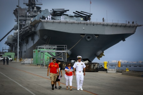 A sailor stationed aboard the USS America LHD-6 spends time with his family before boarding the ship at Naval Base San Diego prior to departing on the America Amphibious Ready Group/15th Marine Expeditionary Unit's Western Pacific 17-2 deployment July 7, 2017. The 15th MEU will provide a forward-deployed, flexible sea-based Marine Air-Ground Task Force capable of conducting a variety of combat and humanitarian missions. (U.S. Marine Corps photo by Sgt. Will Perkins)