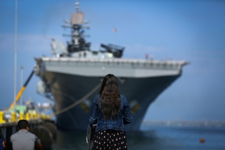A wife and child wait to watch the departure of the America Amphibious Ready Group/15th Marine Expeditionary Unit's Western Pacific 17-2 15th Marine Expeditionary Force at Naval Base San Diego July 7, 2017. The 15th MEU will provide a forward-deployed, flexible sea-based Marine Air-Ground Task Force capable of conducting a variety of combat and humanitarian missions. (U.S. Marine Corps photo by Sgt. Will Perkins)
