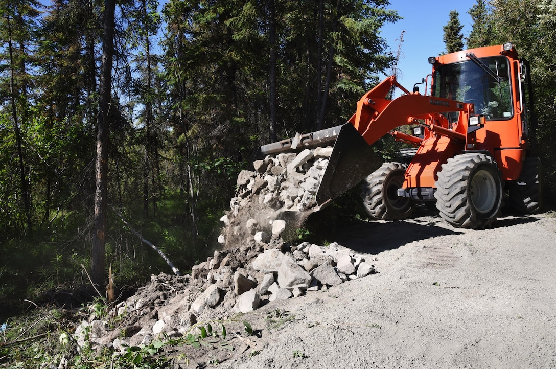 Oregon Air National Guard Senior Airman Andrew Wolf, assigned to the 142nd Fighter Wing Civil Engineers (CES) uses a front end loader to transport rock and gravel to the Nivan Lake Trail at Yellowknife, Northwest Territories, Canada, July 18, 2017. The CES members are spending two-weeks in Canada working on a variety of projects during their Deployment for Training (DFT). (U.S. Air National Guard photo/Master Sgt. John Hughel, 142nd Fighter Wing Public Affairs)