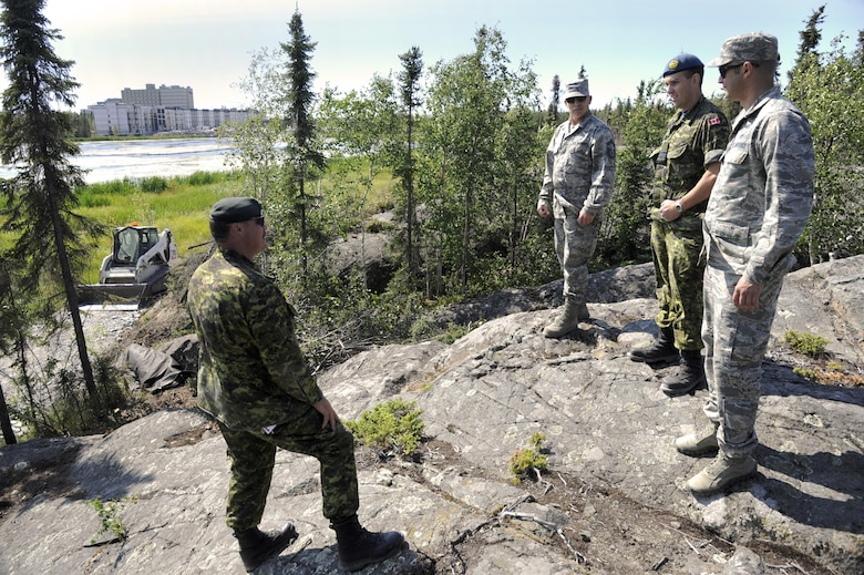 Oregon Air National Guard 142nd Civil Engineer Squadron (CES) and Canadian Armed Forces leaders discuss the Niven Lake trail extension, and other ongoing construction and repair projects that their members are working on around the City of Yellowknife, Northwest Territories, Canada, July 20, 2017.The CES members are spending two-weeks in Canada working on a variety of projects during their Deployment for Training (DFT). (U.S. Air National Guard photo/Master Sgt. John Hughel, 142nd Fighter Wing Public Affairs)