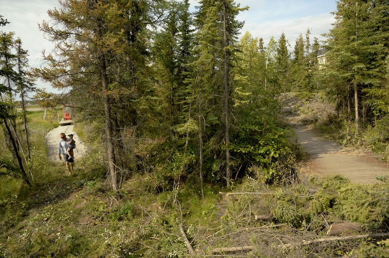 Oregon Air National Guardsmen from the 142nd Fighter Wing Civil Engineer Squadron, Portland, Oregon, work to construct a new pedestrian friendly trail (picture left) at Niven Lake in Yellowknife, Northwest Territories, Canada during their two-week Deployment For Training, July 21, 2017. The Oregon Airmen are also collaborating with Canadian Armed Forces members from Cold Lake, Alberta, who are also deployed to Yellowknife for training. (U.S. Air National Guard photo/Master Sgt. John Hughel, 142nd Fighter Wing Public Affairs)