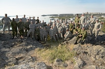 Oregon Air National Guardsmen from the 142nd Fighter Wing Civil Engineer Squadron (CES) along with Canadian Armed Forces Construction Engineers from Cold Lake, Alberta, gather for a group photograph after their two-week Deployment for Training assigment in Yellowknife, Northwest Territories, Canada, July 26, 2017. (U.S. Air National Guard photo/Master Sgt. John Hughel)