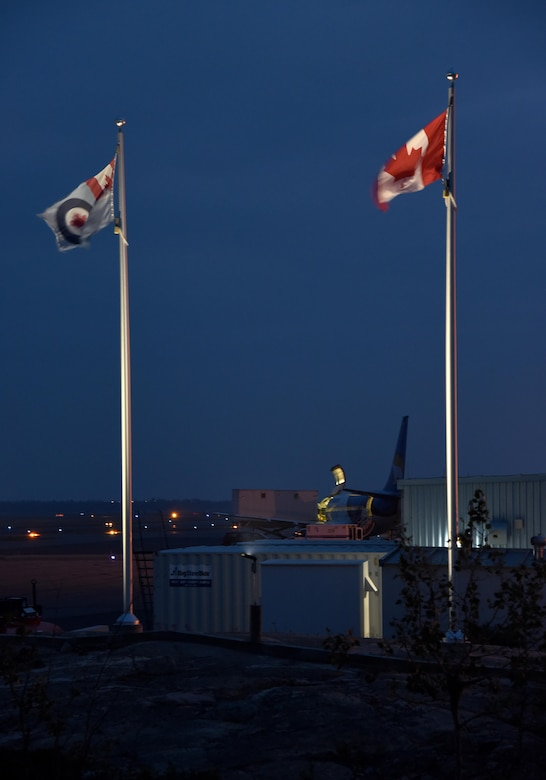 The Canadian Armed Forces 440th Squadron/Escadrille new exterior lighting project eliminates the Canadian and Royal Air Force Flags finished by the Oregon Air National Guard's 142nd Fighter Wing Civil Engineer Squadron during their two-week Deployment to Yellowknife, Northwest Territories, Canada, July 26, 2017. (U.S. Air National Guard photo/Master Sgt. John Hughel, 142nd Fighter Wing Public Affairs)