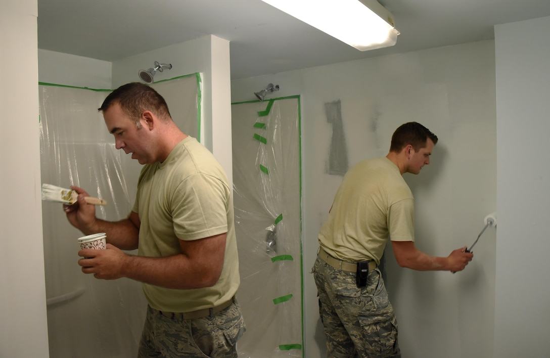 Oregon Air National Guard Staff Sgt. Tyler O'Bryant (left), and Staff Sgt. Zachariah Lewis (right), assigned to the 142nd Fighter Wing Civil Engineer Squadron, apply paint to  a shower repair project during their Deployment For Training (DFT) in Yellowknife, Northwest Territories, Canada, July 27, 2017. The Oregon Airmen are also collaborating with Canadian Armed Forces members from Cold Lake, Alberta, who are also deployed to Yellowknife for training. (U.S. Air National Guard photo/Master Sgt. John Hughel, 142nd Fighter Wing Public Affairs)