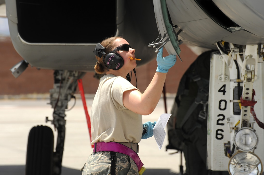 Oregon Air National Guard Senior Airman Aimee Lonidier, a crew chief with the 142nd Fighter Wing does a post flight check of an F-15 Eagle at Nellis Air Force Base, Nev., during the Weapons Instructor Course, May 30, 2017 (U.S. Air National Guard photo by Master Sgt. John Hughel, 142nd Fighter Wing Public Affairs).