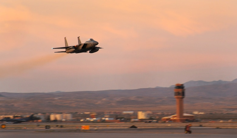 An Oregon Air National Guard F-15 Eagle, assigned to the 142nd Fighter Wing, takes off from Nellis Air Force, Nev., on a late day sortie, June 8, 2017. Over 120 Oregon Air Guardsmen are supporting the Weapons Instructor Course during their three-week duty assignment. (U.S. Air National Guard photo by Master Sgt. John Hughel, 142nd Fighter Wing Public Affairs)