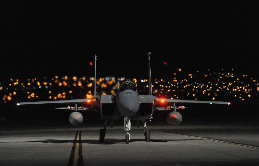 An Oregon Air National Guard F-15 Eagle, assigned to the 142nd Fighter Wing, returns to Nellis Air Force, Nev., after a late day sortie in support of the Weapons Instructor Course, June 8, 2017. Over 120 Oregon Air Guardsmen are supporting the Weapons Instructor Course during their three-week duty assignment. (U.S. Air National Guard photo by Master Sgt. John Hughel, 142nd Fighter Wing Public Affairs)