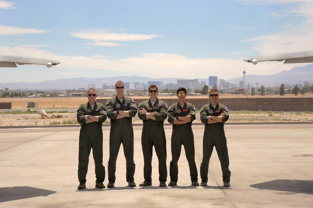 U.S. Air Force fighter pilots completing their 6-month course at Nellis Air Force Base, Nev., (from left to right) Maj. Kevin Danaher, Capt. Ryan Sivertsen, Capt. Matt Tanis, Capt. Nathan Liptak, and 142nd Fighter Wing Maj. Bradley Young, pause for a group photograph, June 10, 2017. (U.S. Air National Guard photo by Master Sgt. John Hughel, 142nd Fighter Wing Public Affairs)