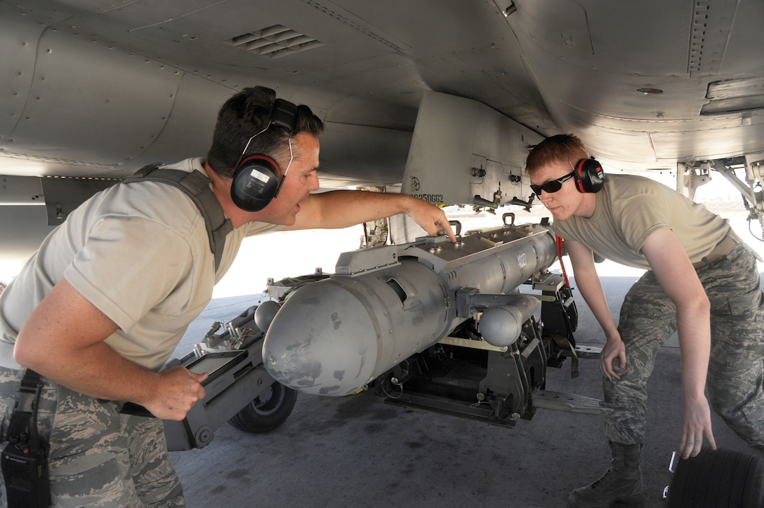 Oregon Air National Guard Avionics Technicians Master Sgt. Haina Searls (left) and Senior Airman Darian Forbes (right), assigned to the 142nd Fighter Wing Maintenance Group, work to install the AN/ALQ-188 pod to a F-15 Eagle, assigned to the 142nd Fighter Wing prior to an afternoon flight in support of the Weapons Instructor Course at Nellis Air Force Base, Nev., June 14, 2017. (U.S. Air National Guard photo by Tech. Sgt. John Hughel, 142nd Fighter Wing Public Affairs)