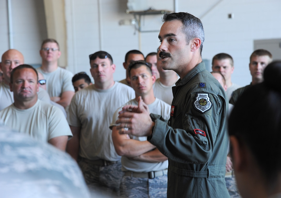 Oregon Air National Guard Lt. Col. Aaron Mathena, 123rd Fighter Squadron commander, spends time thanking and providing thoughtful feedback to members of the 142nd Fighter Wing who spent the last three-weeks at Nellis Air Force Base, Nev., supporting the Weapons Instructor Course.